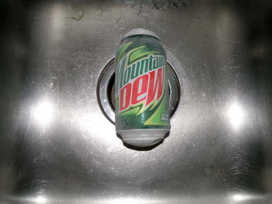 Frozen, bulged can of Mountain Dew
