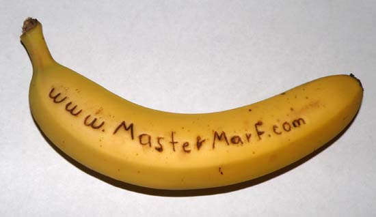 Web address written on a banana