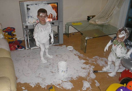 Kids covered in white paint.