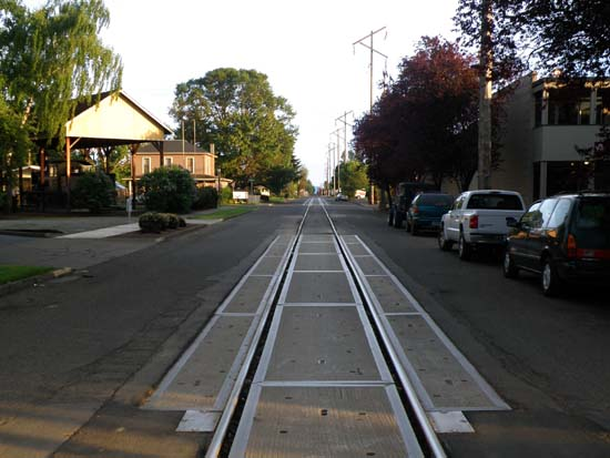 Railway tracks down the middle of the road.