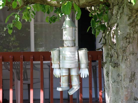 Tin man hanging in a tree.