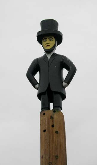 Abraham Lincoln on top of a totem pole.