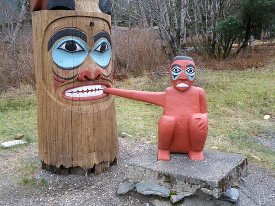 Hand being eaten by totem pole