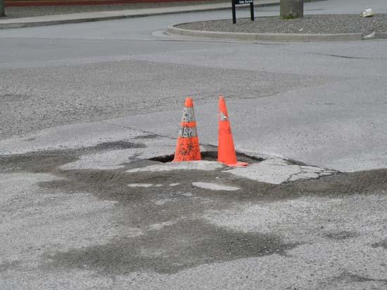 Cones in a pothole.