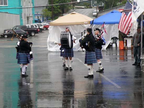 Misty Thistle Pipes & Drums playing in the rain